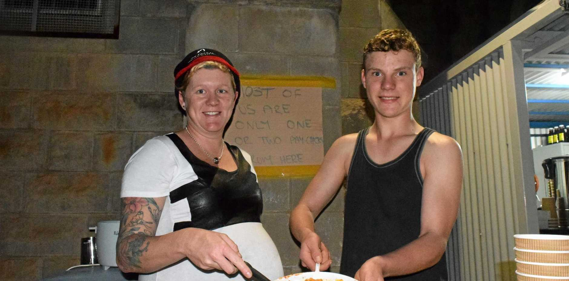 MEAL TIME: Anglicare's Toni Smith serves sleepout participant Baringa a hot meal at the Anglican Sleepout on Friday night.