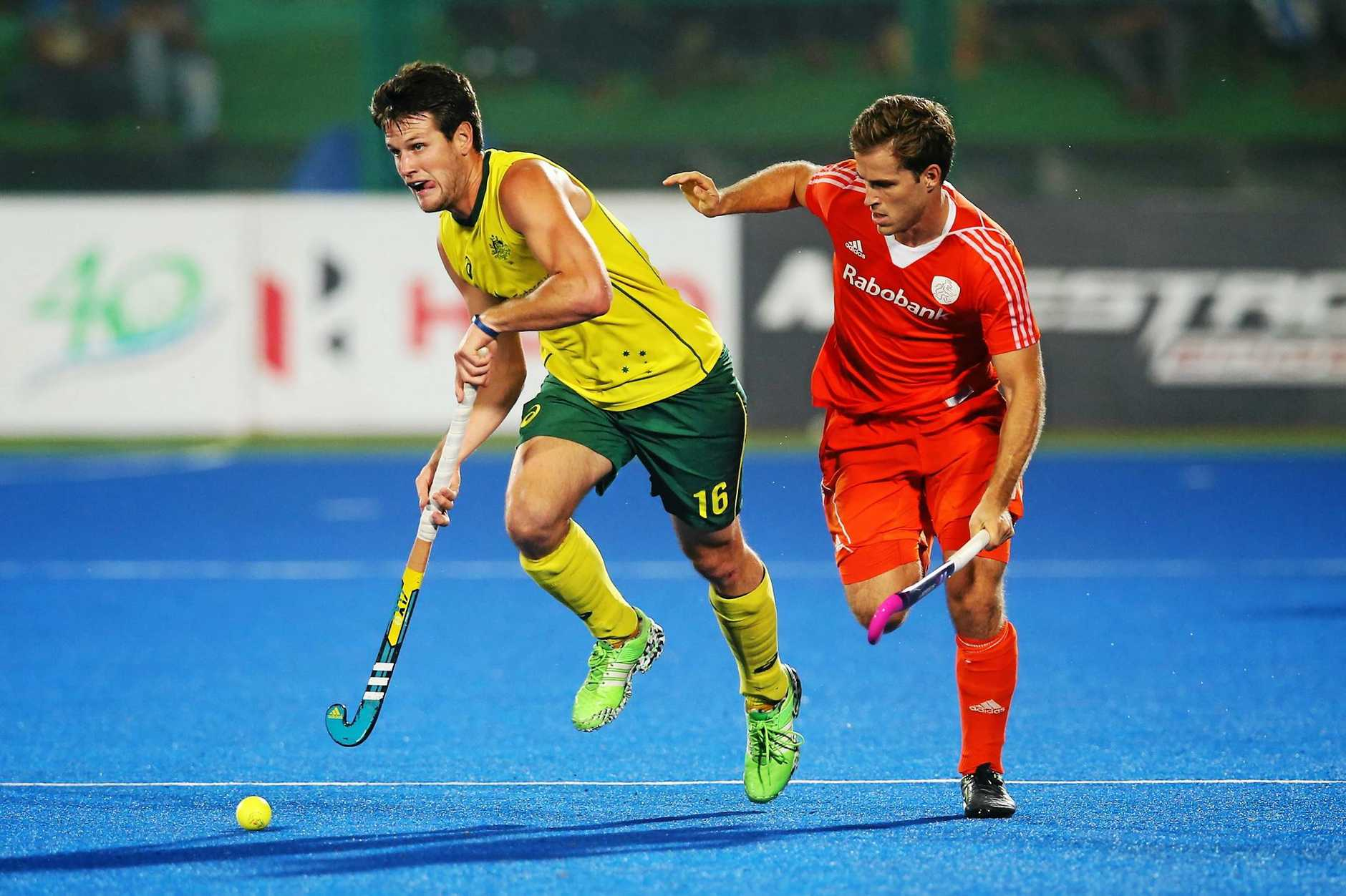 RAIPUR, INDIA - DECEMBER 04:  Matt Gohdes of Australia runs with the ball during the match between Australia and Netherlands on day eight of The Hero Hockey League World Final at the Sardar Vallabh Bhai Patel International Hockey Stadium on December 04, 2015 in Raipur, India. (Photo by Ian MacNicol/Getty images)