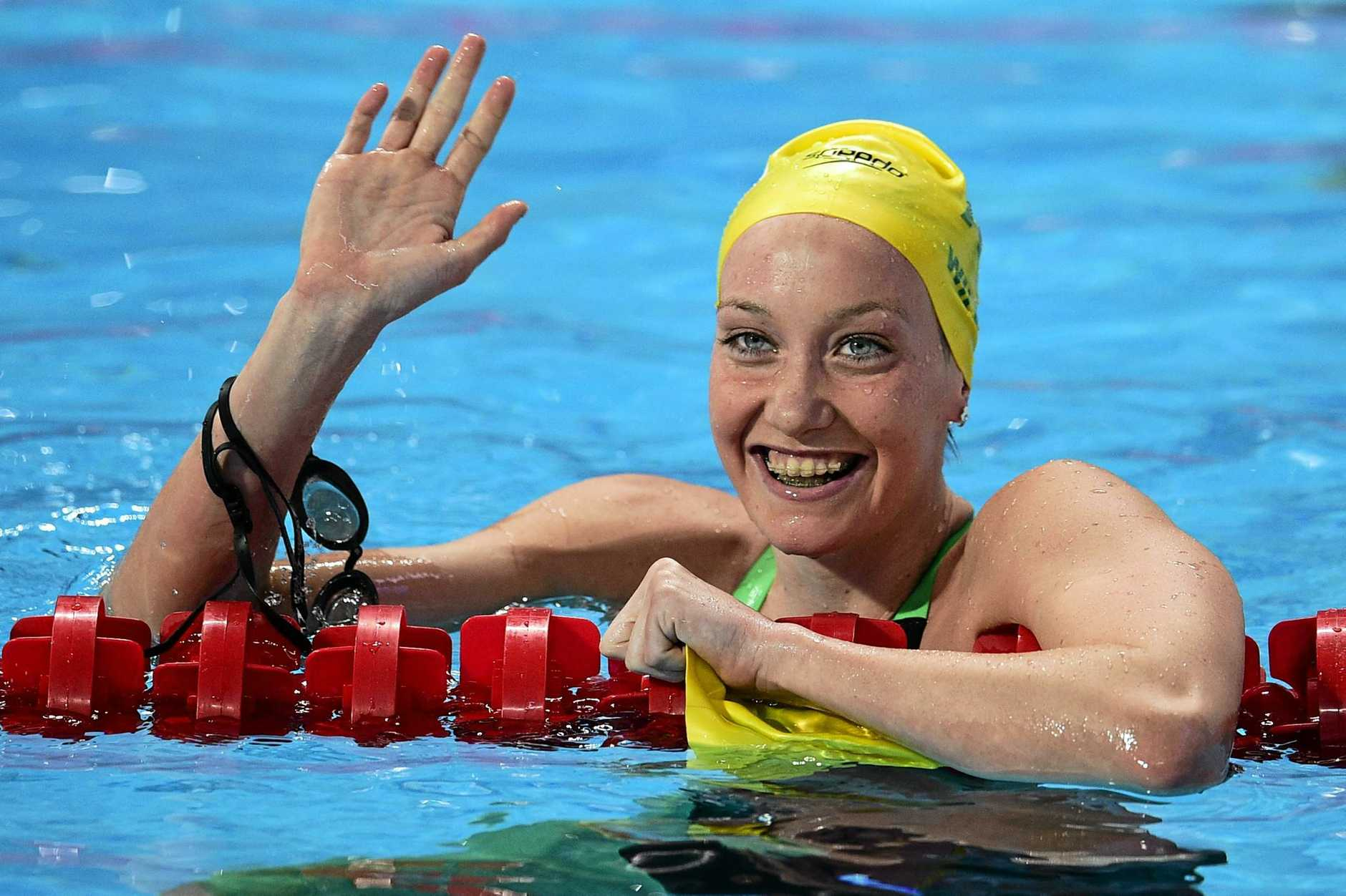 Australia's Madison Wilson, celebrates after winning the silver in the final of the women's 100m backstroke swimming event at the 2015 FINA World Championships in Kazan on August 4, 2015.    AFP PHOTO / MARTIN BUREAU