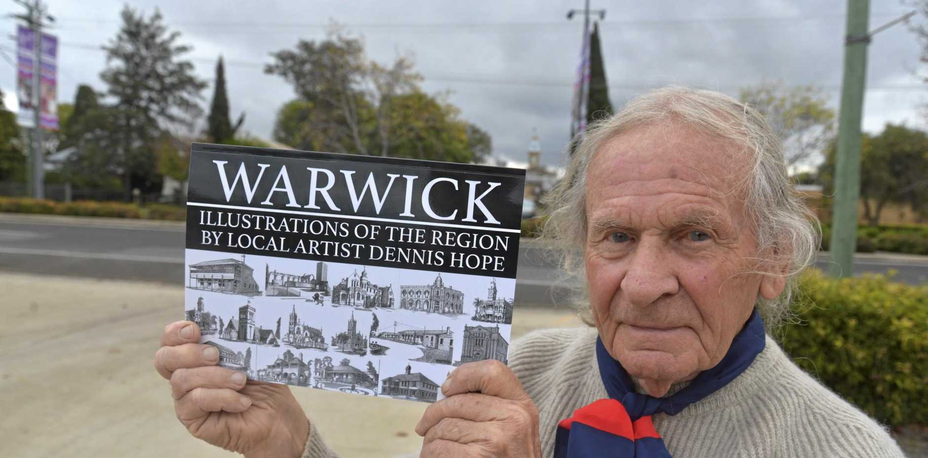 OUR REGION: Dennis Hope with his newly published book of drawings of Southern Downs landmarks.