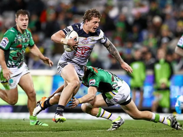 RISING STAR: Josh Chudleigh of the Cowboys runs the ball during the round 18 NRL match against the Canberra Raiders.