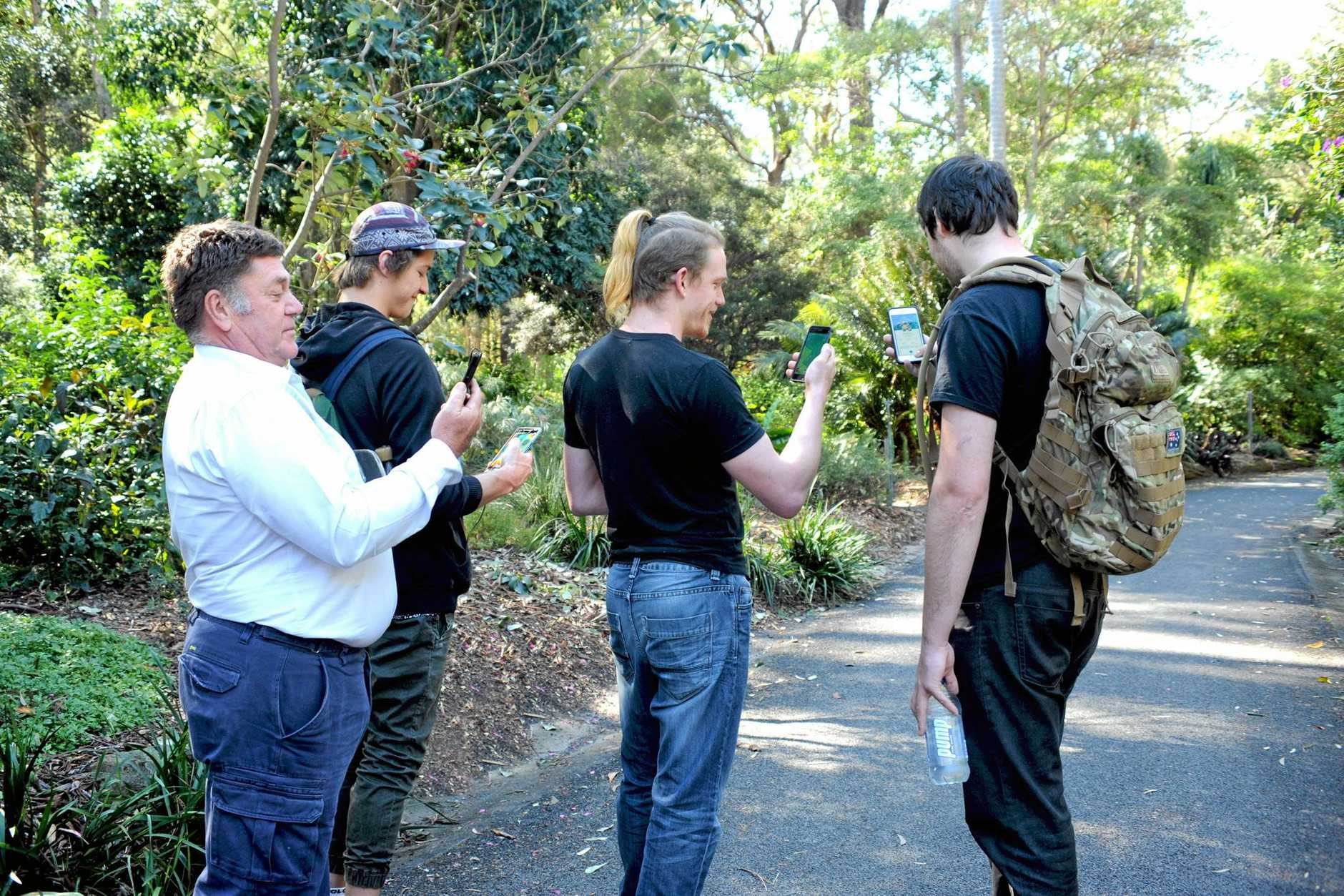 Pokemon Go players at the Botanical Gardens, Coffs Harbour.Ian Corbett [Gardens Curator} with Aaron Patterson, Michael Drews and Jonothon Mackay playing the game.25  july  2016.