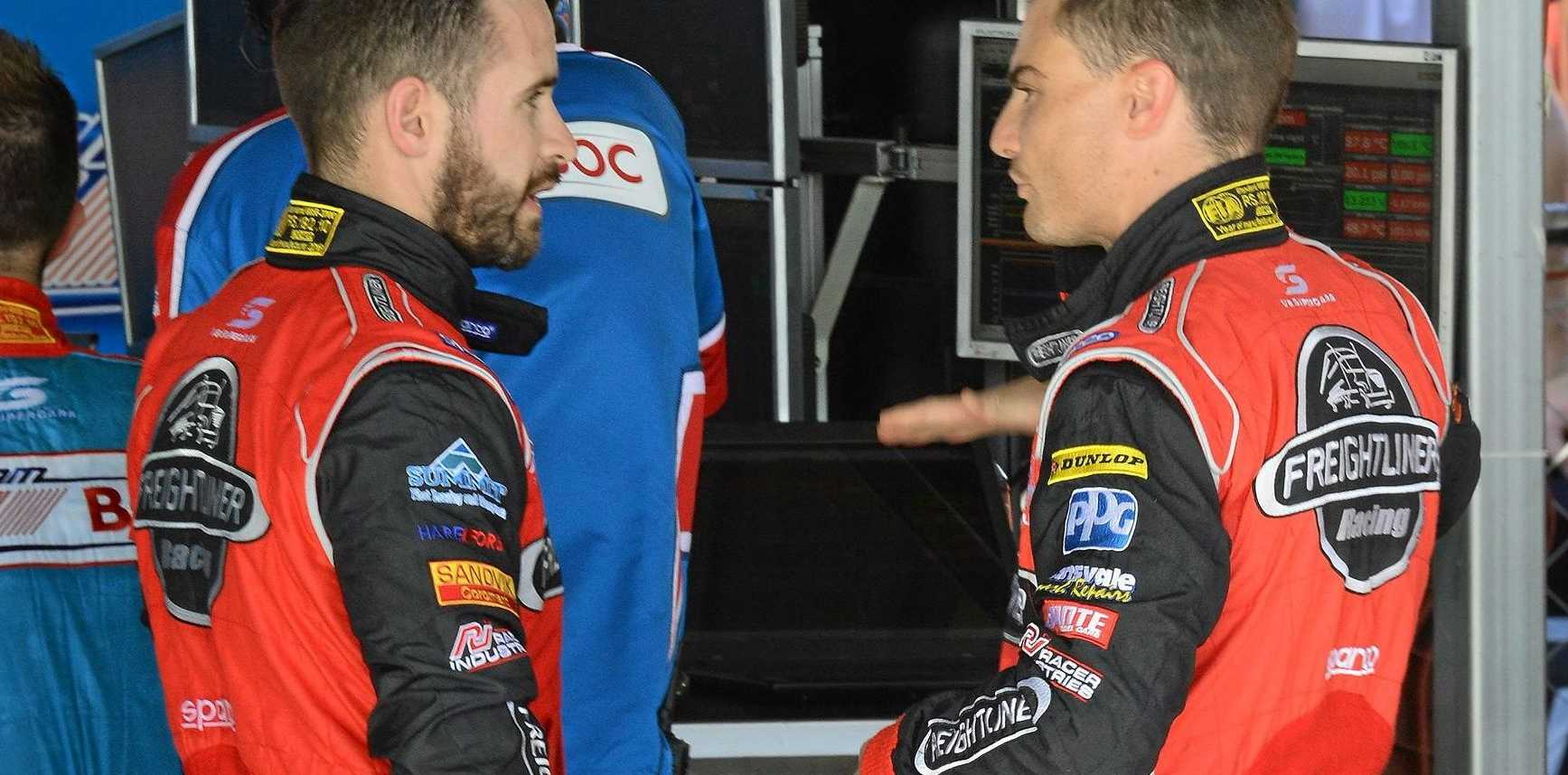 Ipswich racer Ash Walsh (left) discusses tactics with Supercars driver Tim Slade after a co-drivers practice session at Queensland Raceway.