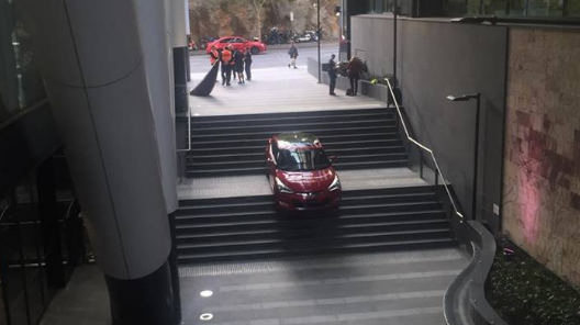 Brisbane car suspended on stairwell