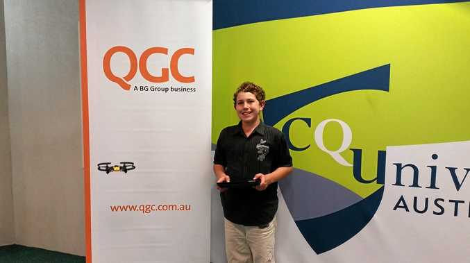 NEW HEIGHTS: Luke Pfieffer plays with a drone at CQUniversity to celebrate a $42,178 QGC grant.