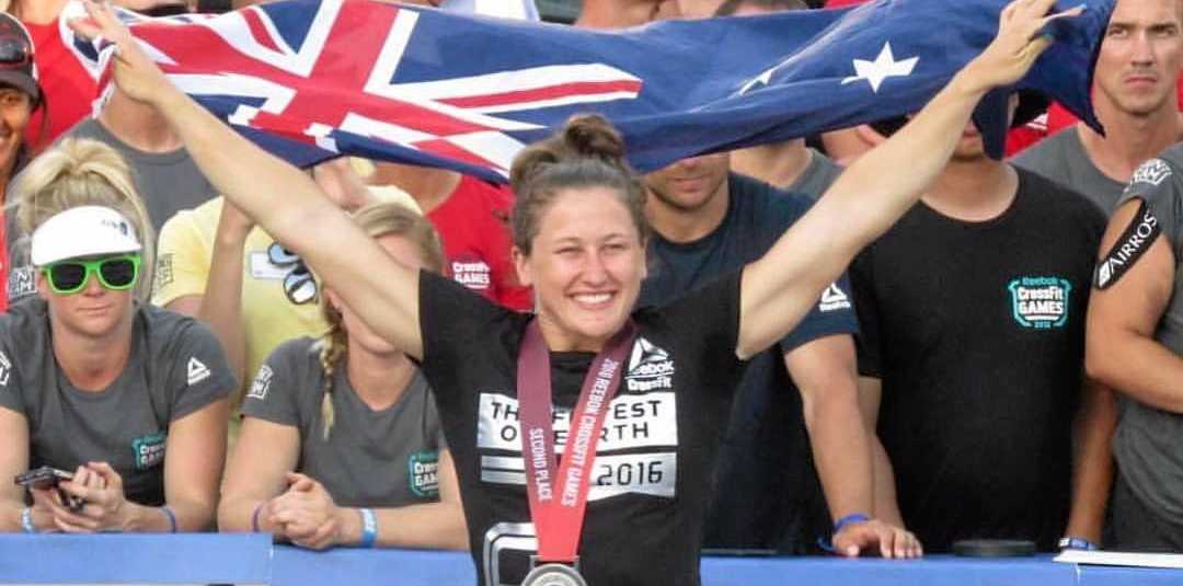 PROUD AUSSIE: Gladstone's Tia-Clair Toomey takes the podium for Australia, finishing second at the CrossFit Games. She will now prepare for weightlifting at the Rio Olympics.