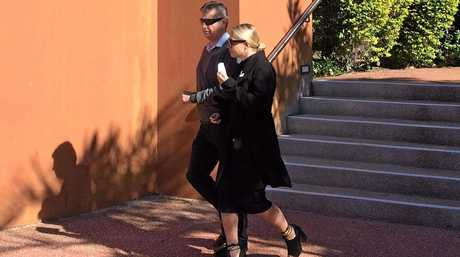 Radio identity Sommer Price leaves Gladstone Courthouse where she appeared charged with fraud offences.
