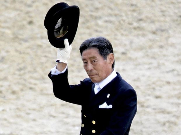 VETERAN OLYMPIAN: Hiroshi Hoketsu, of Japan, tips his hat to the crowd after competing with his horse Whisper in the equestrian dressage at the 2012 London Olympics.