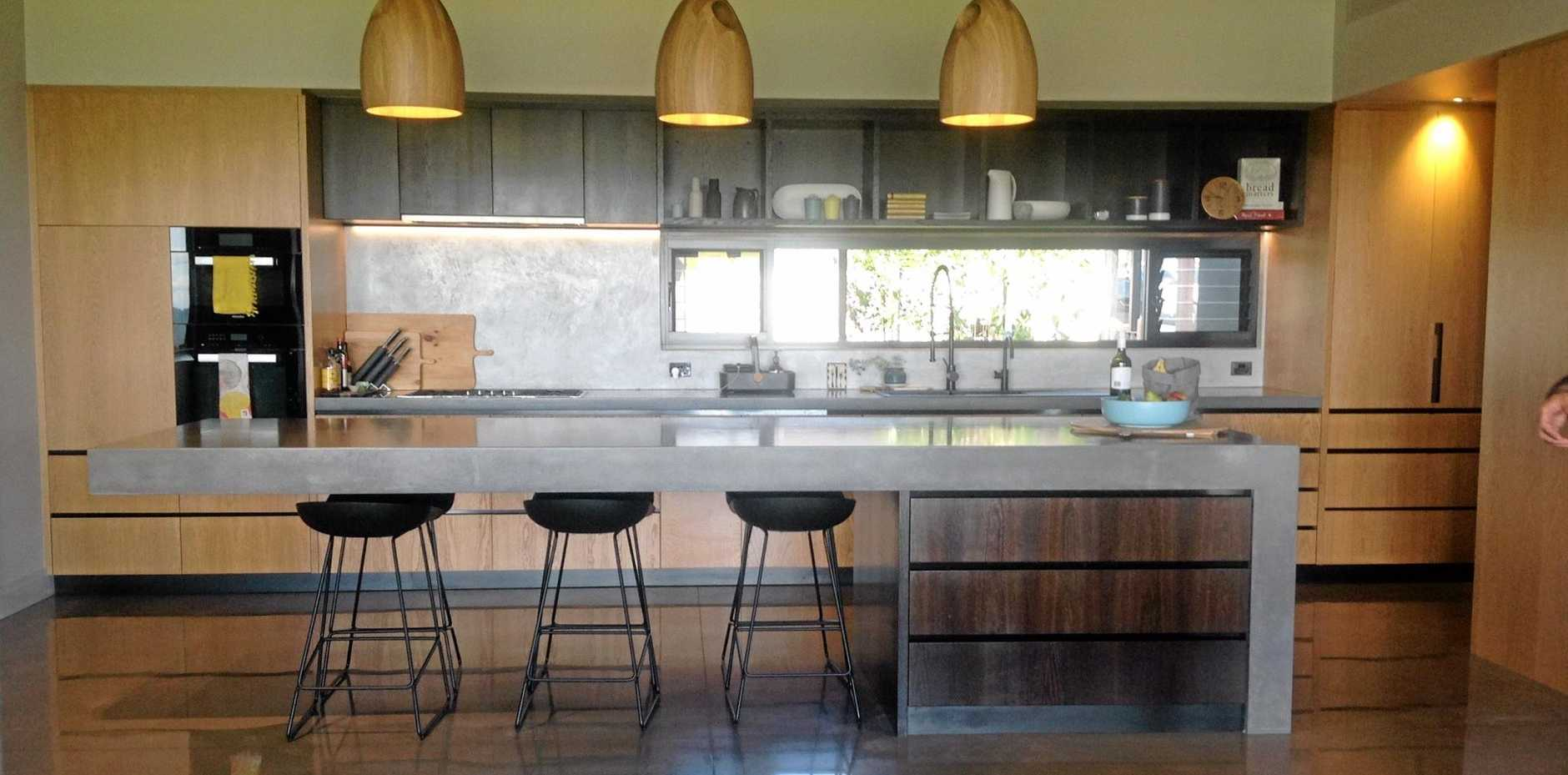 Cantilevered concrete bench featured in this stunning hinterland kitchen.