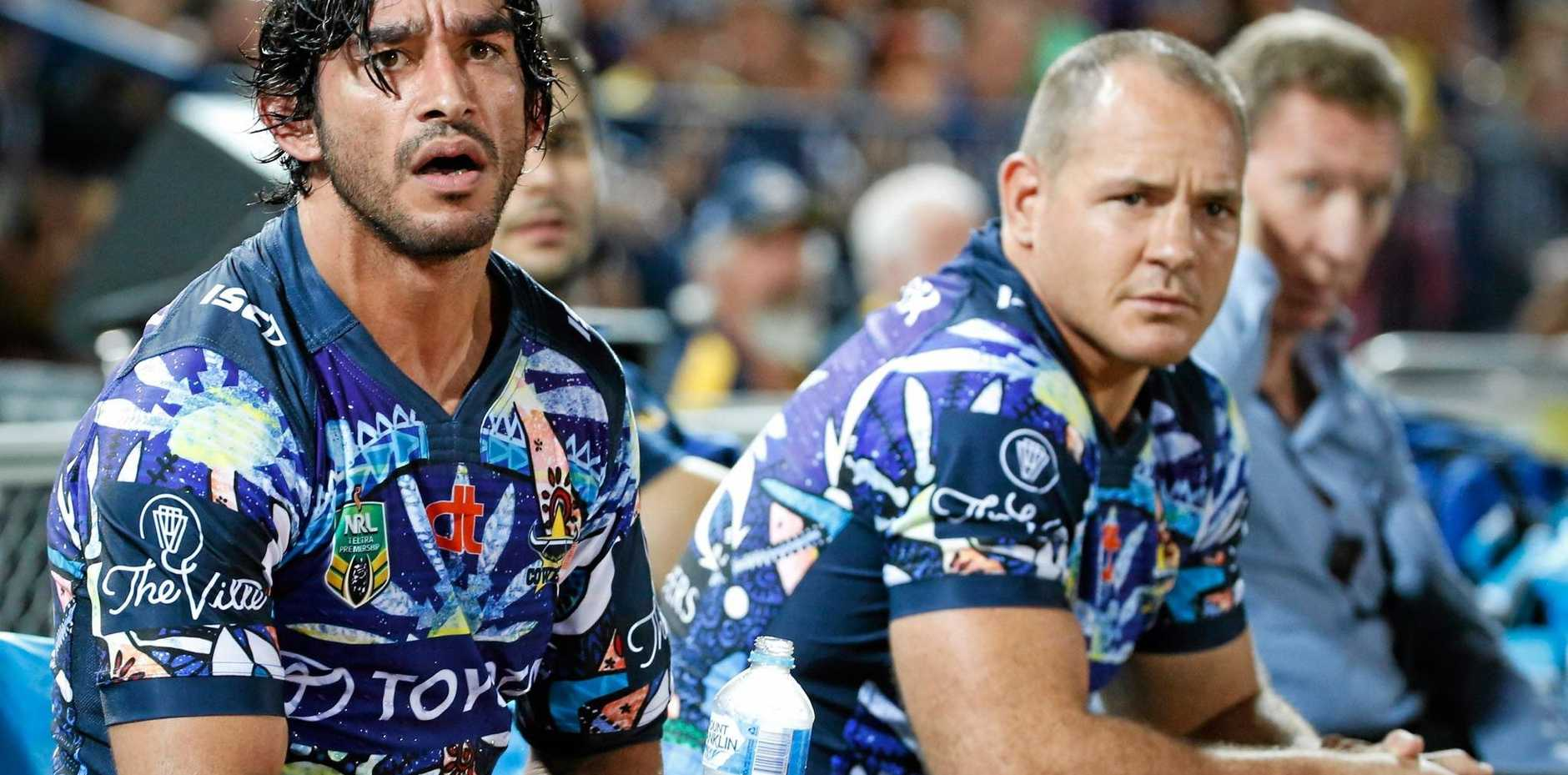INJURY CLOUD: Johnathan Thurston (left), with his leg iced, watches from the bench during the clash between the North Queensland Cowboys and the Canterbury-Bankstown Bulldogs last weekend.