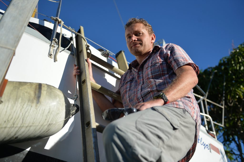 Martin Dolecek fixing his boat in Mackay before he continues his solo journey around the world