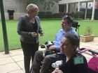 Happy Paws Happy Hearts clients Tim and Charne with RSPCA puppies Flake and Crunchy and Disability Services Minister Coralee O'Rourke.