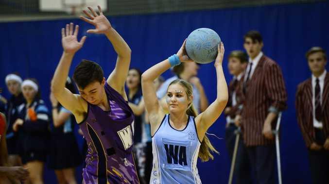 Ipswich Girls Grammar School Vs Ipswich Grammar School prefect netball match at IGGS (boys vs girls). IGGS player Shannon Trigger dominates her opponent.