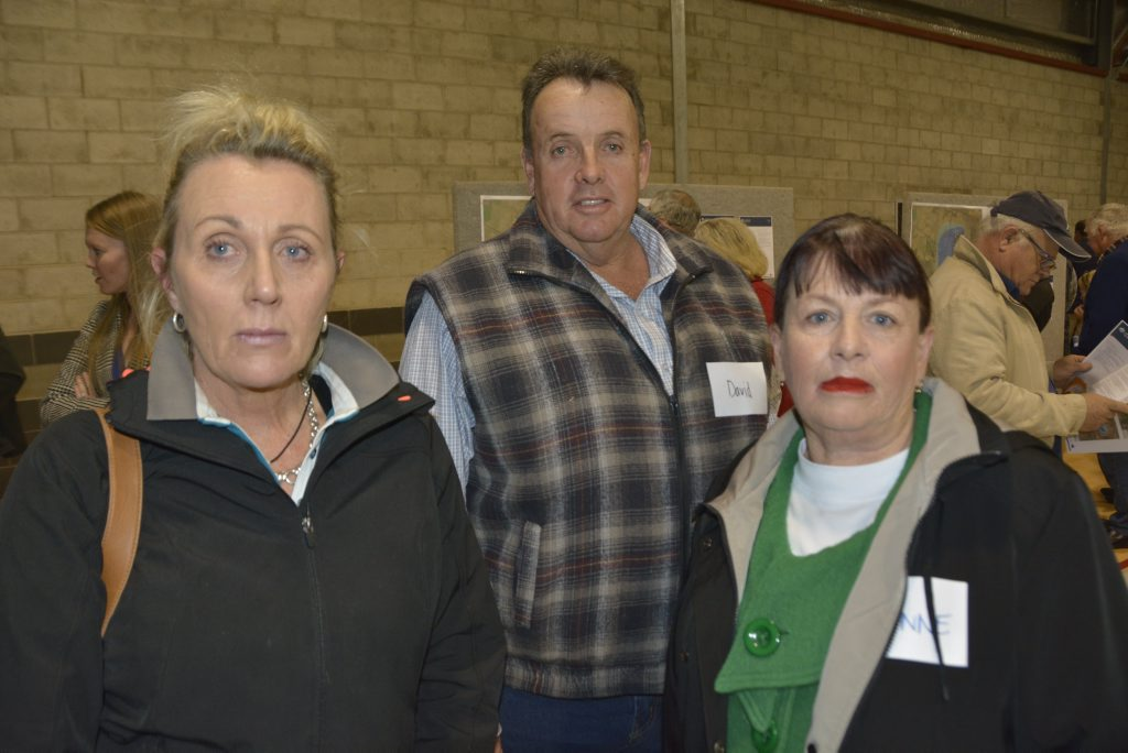 Jennifer Spencer and (left to right) Berwick Stud owners David Jefferis and Dianne Priddle review the updated maps and contamination zones at the Oakey groundwater contamination information session.