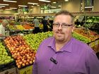 NO WORRIES HERE: Woolworths store manager Jeremy O'Mara hard at work. Gympie region's three Woolworths supermarkets are safe from a recently announced round of closures.