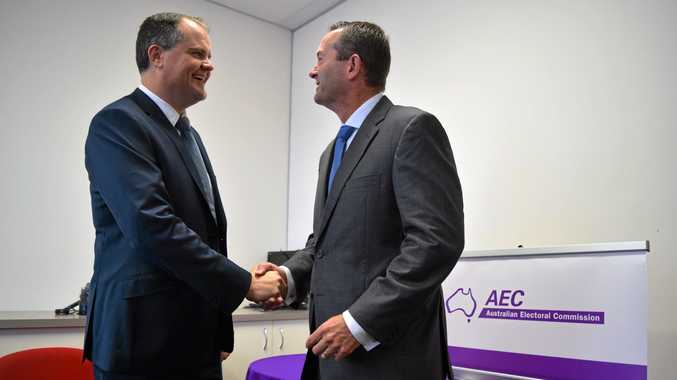 WINNERS: Declared MPs for Fairfax and Fisher, Ted O'Brien (left) and Andrew Wallace congratulate each other.