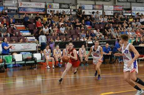 Meteorettes' Kelsey McDermott dribbles towards the hoop.
