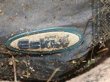 An esky bag containing a wrapped up axe and a brick is described as a Nylex brand, silver and navy blue bag.
