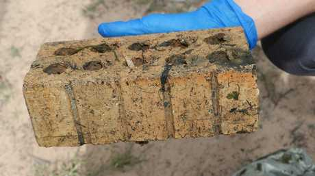 A brick believed to weigh down an esky bag containing an axe.