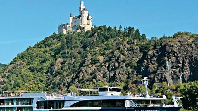 River cruise passengers marvel at Marksburg Castle as it rises high above the Rhine. The castle dates back to 1117.
