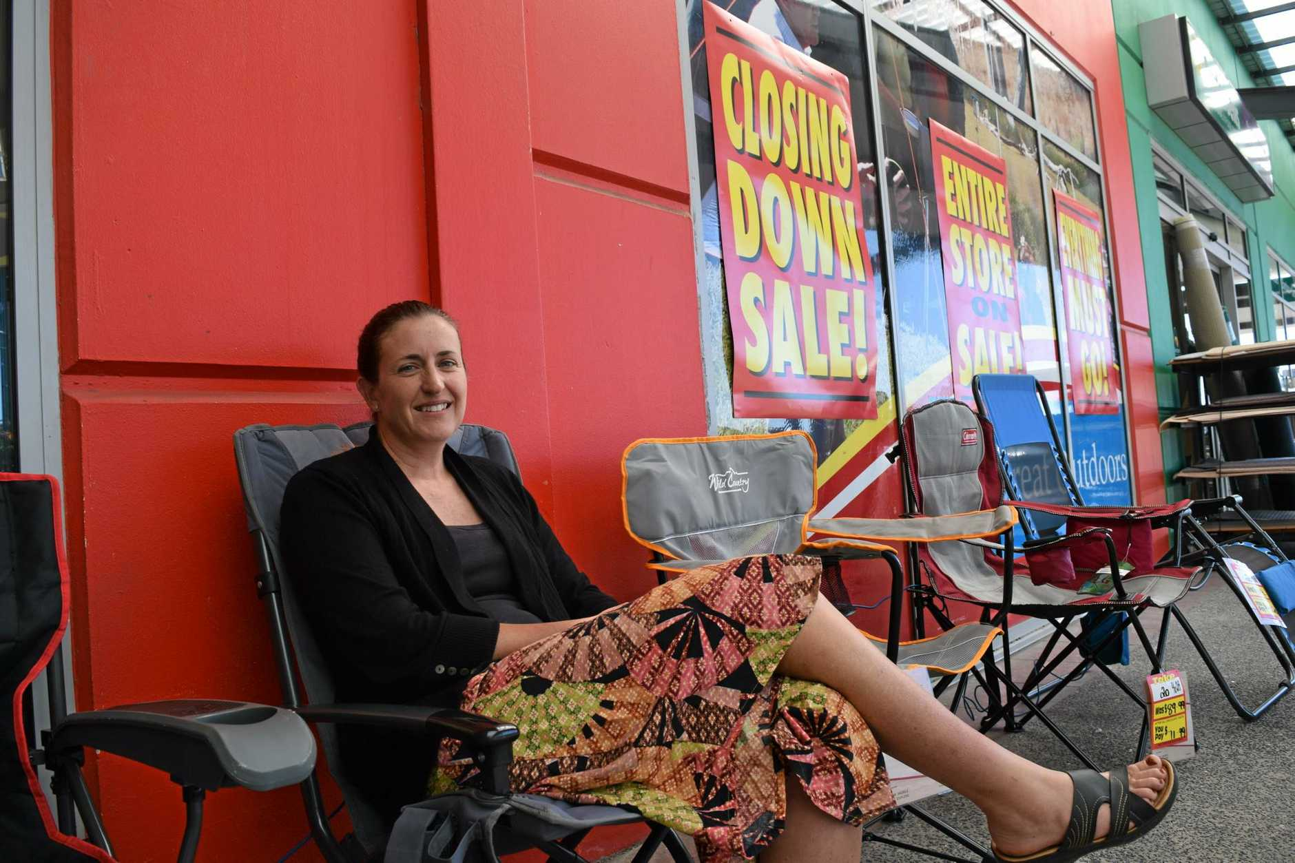 Kirstie Henning considers the discounted chairs at Ray's Outdoors Maroochydore, which is closing down.