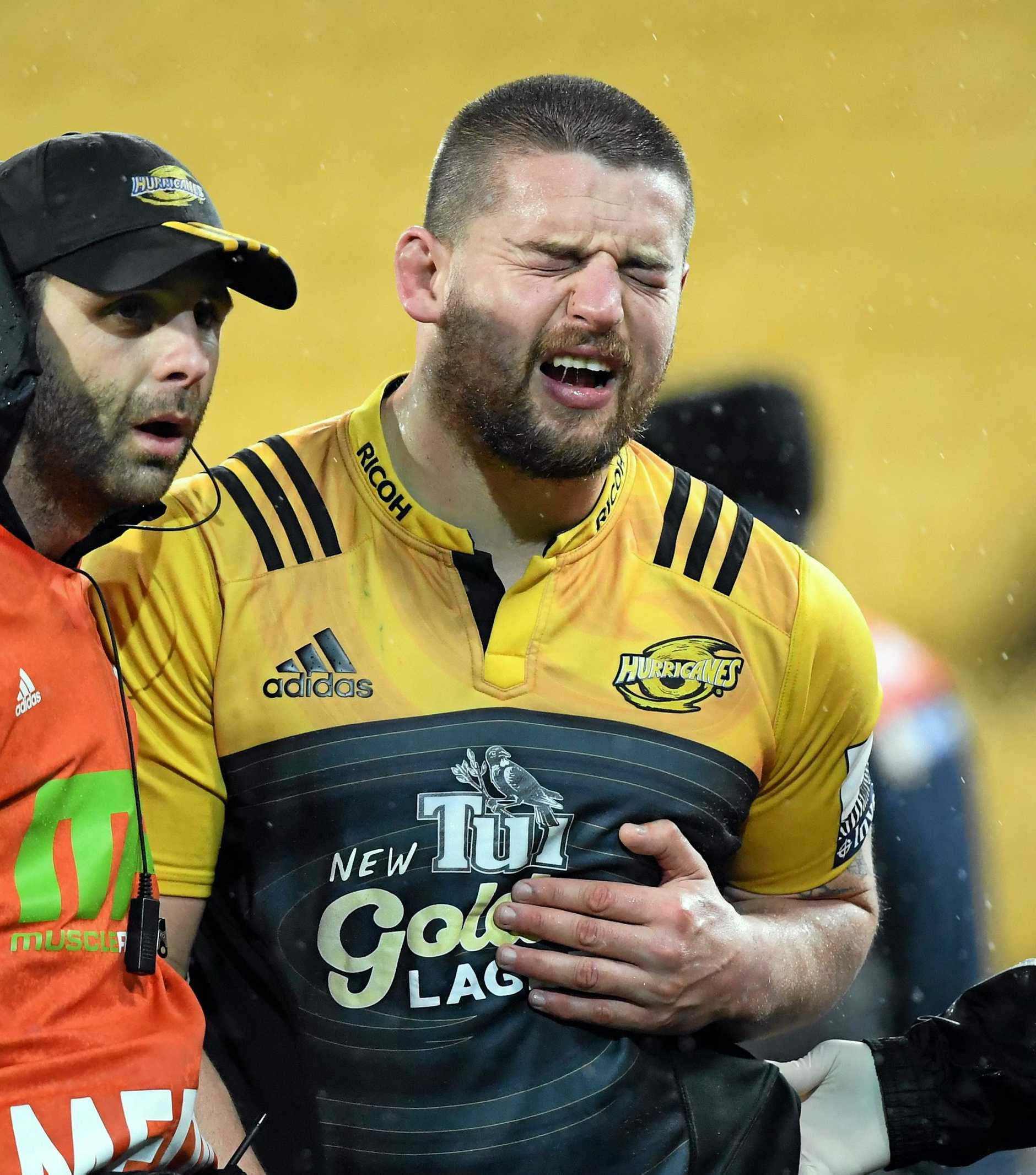 IN DOUBT: Dane Coles of the Hurricanes leaves the field injured during the quarter-final between the Hurricanes and the Sharks.