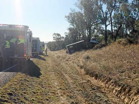 Emergency services at the scene of a single-vehicle crash north of Roma on Thursday.