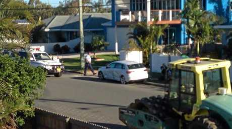 Police swarm on two men, arrested on a busy suburban road at Cabarita.