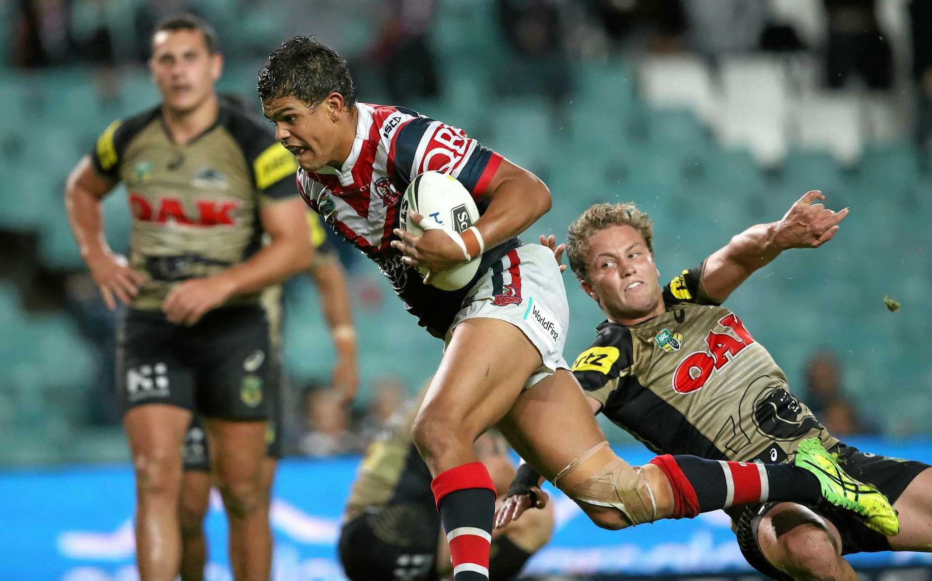 Sydney Roosters' Latrell Mitchell breaks with the ball to score his second try against the Penrith Panthers during the round 7 NRL match between the Penrith Panthers and the Sydney roosters at  Allianz Stadium in Sydney on Monday, April 18, 2016. (AAP Image/David Moir) NO ARCHIVING, EDITORIAL USE ONLY