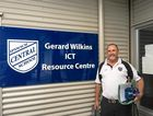 Gerard Wilkins outside the building that now bears his name at Ipswich Central State School.