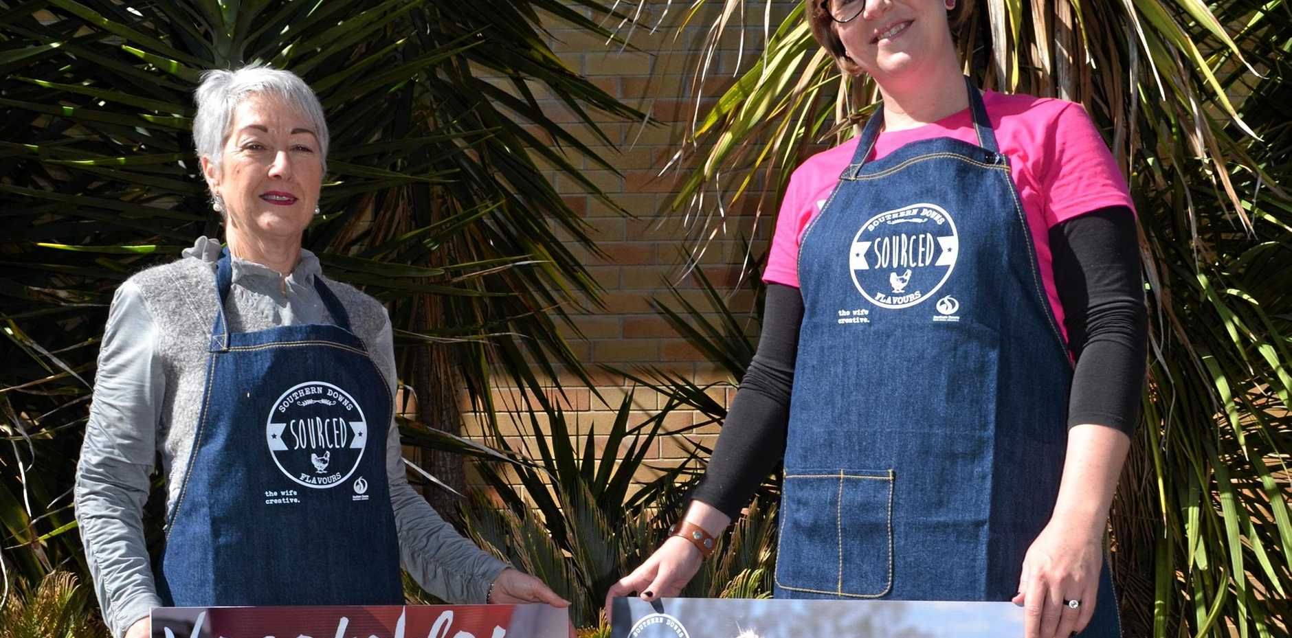 SOURCED FRESH: Mayor Tracy Dobie and Sourced spokeswoman Amy Walker get kitted up for the Stroll 'n' Swing markets today.