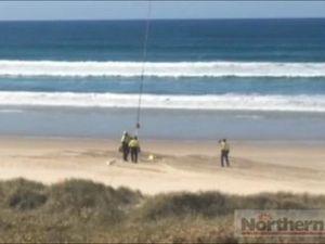 Helicopter delivers shark barrier