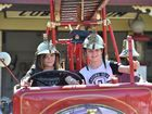 Hervey Bay Historical Village and Museum - Xmas in July. Troy and Cody Godfrey from Hervey Bay take a ride in the 1932 fire engine.