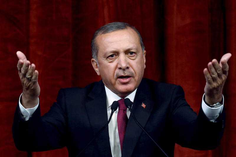 Turkey President Recep Tayyip Erdogan delivers a speech commenting on those killed and wounded during a failed July 15 military coup, in Ankara, Turkey, late Friday, July 29, 2016. The government crackdown in the coup's aftermath has strained Turkey's ties with key allies including the United States.