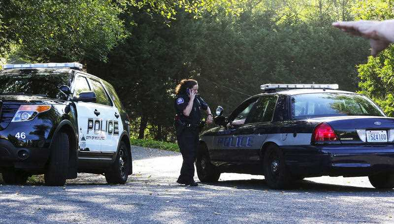 Mukilteo police monitor the access point to the crime scene from a block away, after a shooting in Mukilteo, Wash., Saturday July 30, 2016. A suspect was apprehended three counties away, said Officer Myron Travis of the Mukilteo Police Department.