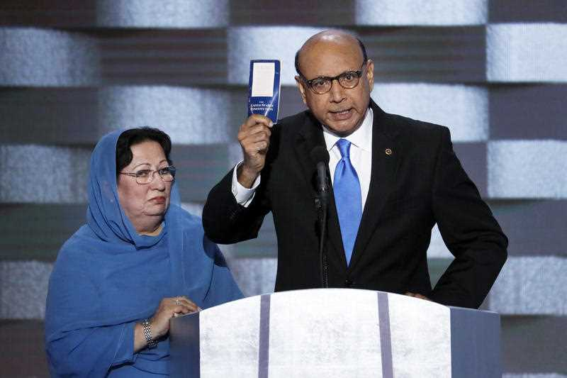 Khizr Khan, father of fallen US Army Capt. Humayun S. M. Khan holds up a copy of the Constitution of the United States as his wife listens during the final day of the Democratic National Convention in Philadelphia , Thursday, July 28, 2016.