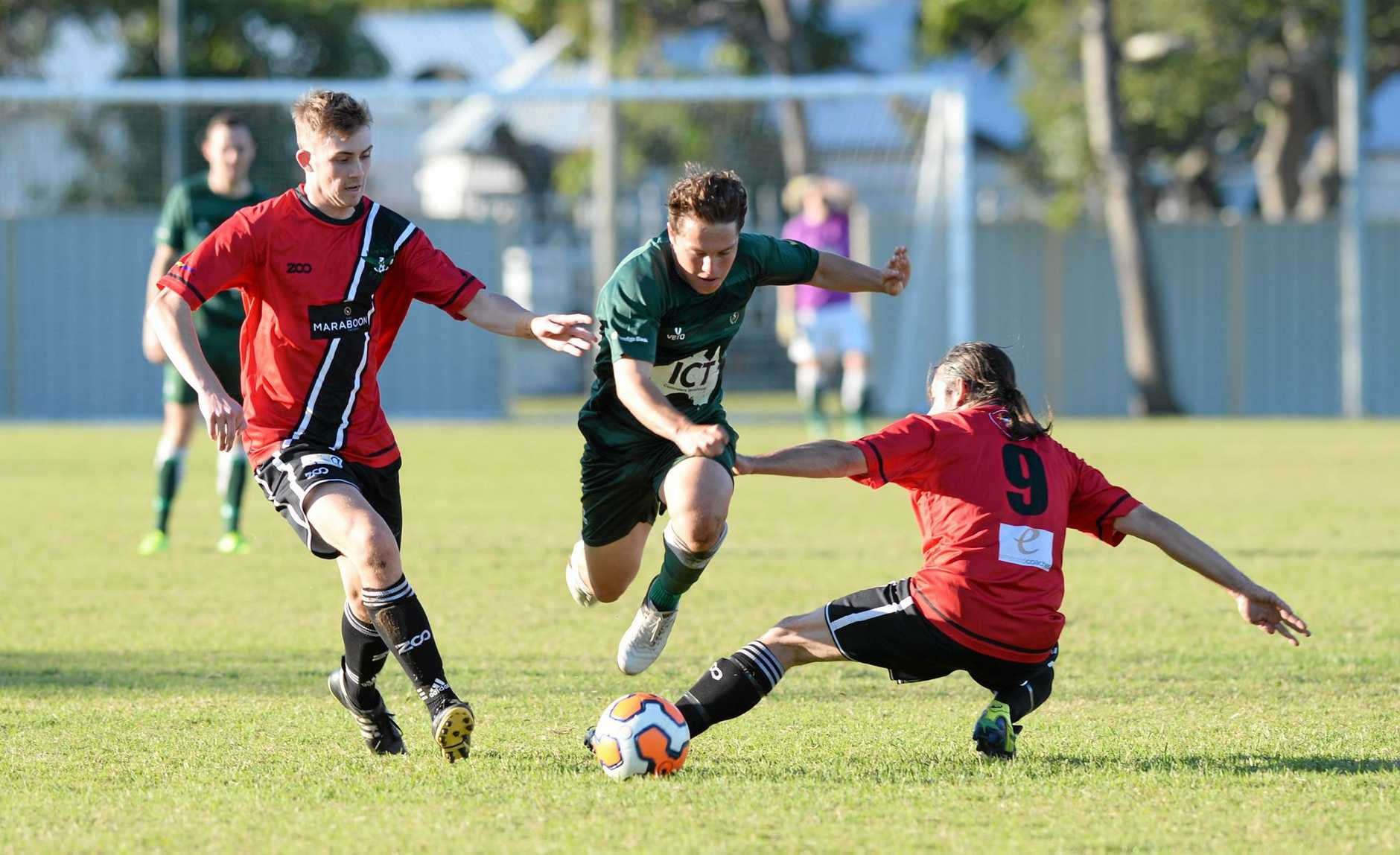 Frenchville's Tim Zimitat gets passed Eagles' Tom Conway and Michael Tominich.Photo Allan Reinikka / The Morning Bulletin