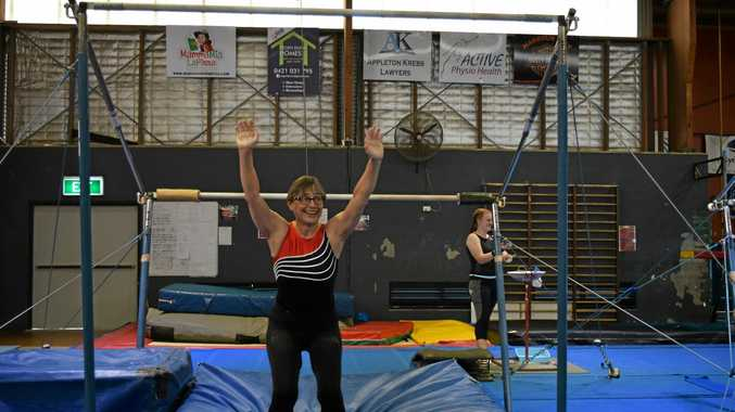 NEVER TOO OLD: At 66-years-old, Laureen Tkacik is still hanging in there on the uneven bars.