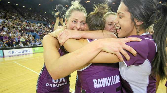 Captain Laura Geitz, of the Firebirds, celebrates with team mates after winning the grand final match of the ANZ Championship between the Queensland Firebirds and the NSW Swifts at the Brisbane Entertainment Centre in Brisbane, Sunday, July 31, 2016. (AAP Image/Glenn Hunt) NO ARCHIVING, EDITORIAL USE ONLY