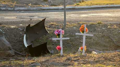 Roadside white crosses could be joined by another after a 45-year-old woman was killed in a car crash