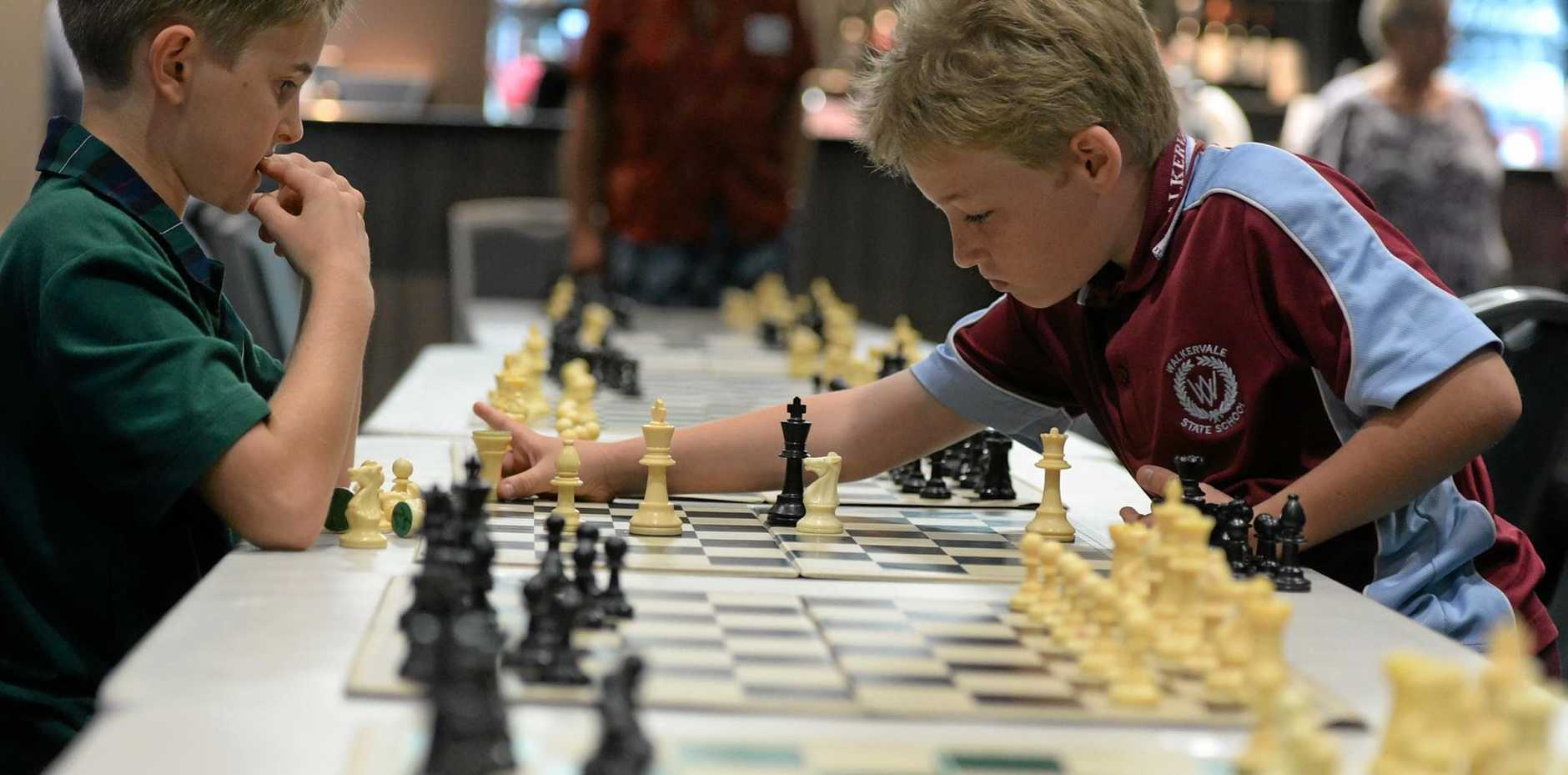 CONCENTRATION: Declan Bertoli and Cyle Swann at a school's chess tournament last year.
