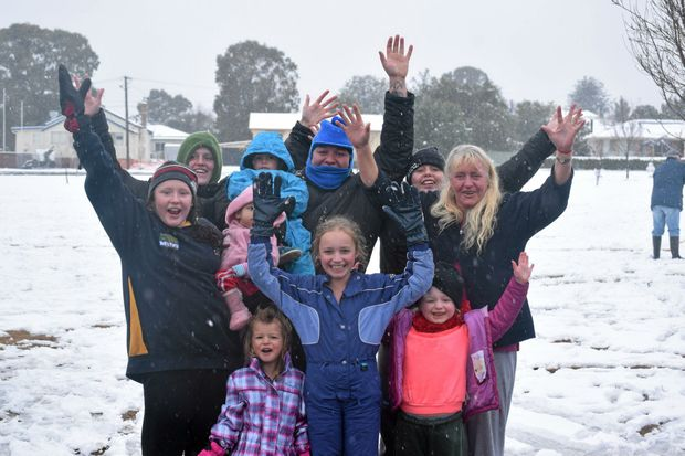 LET IT SNOW: Sally, Cassie and Candy Robinson with Areiellah, Bryan and Kanahri Andrews, Elanie Elara, Taneequa and Phoenix Andrews and Pauline Robinson enjoying the amazing drop of 2015 snow.