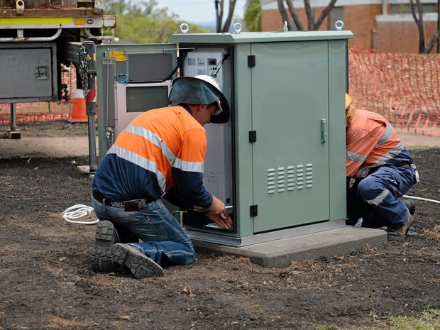 Workers install a NBN cabnet at Agnes Street as work starts on the roll out in Rockhampton. Photo Allan Reinikka / The Morning Bulletin