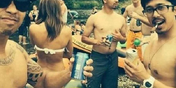 This man's arm is just in the right place and bent at such an angle that the woman looks like she has lost her bikini bottoms.