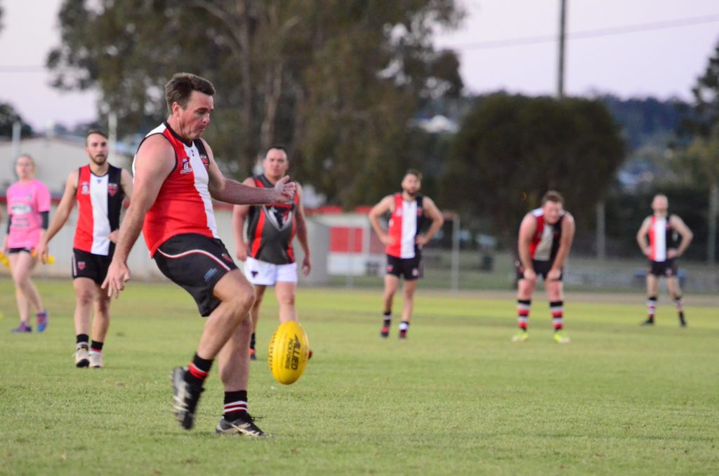 Saints' Adam Branch kicks a goal in the Saints v Demons game in Kingaroy on Saturday, July 30.