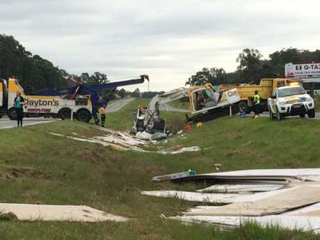 The truck that rolled on the Bruce Hwy at Palmview this morning was smashed to pieces.