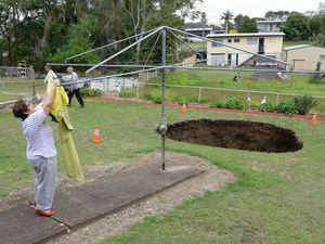 Land swallowed by massive Ipswich sink hole
