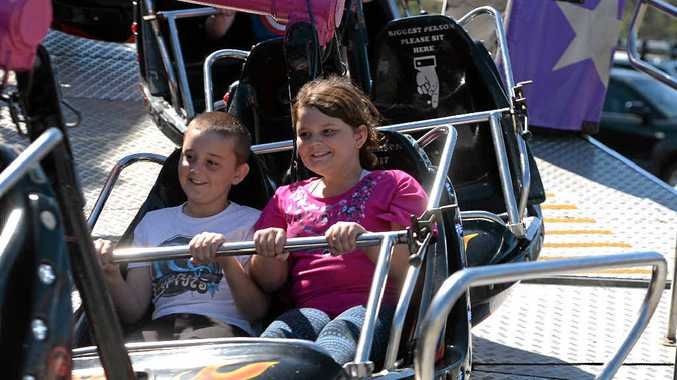 ALL SMILES: Ethan and Savannah Mansfield ride the Midnight Express at the Sarina Show one of many rides on offer.
