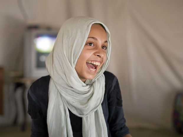 Miriam (Musaa's daughter) in the family tent. Camp Mercy, Bekaa Valley Lebanon
