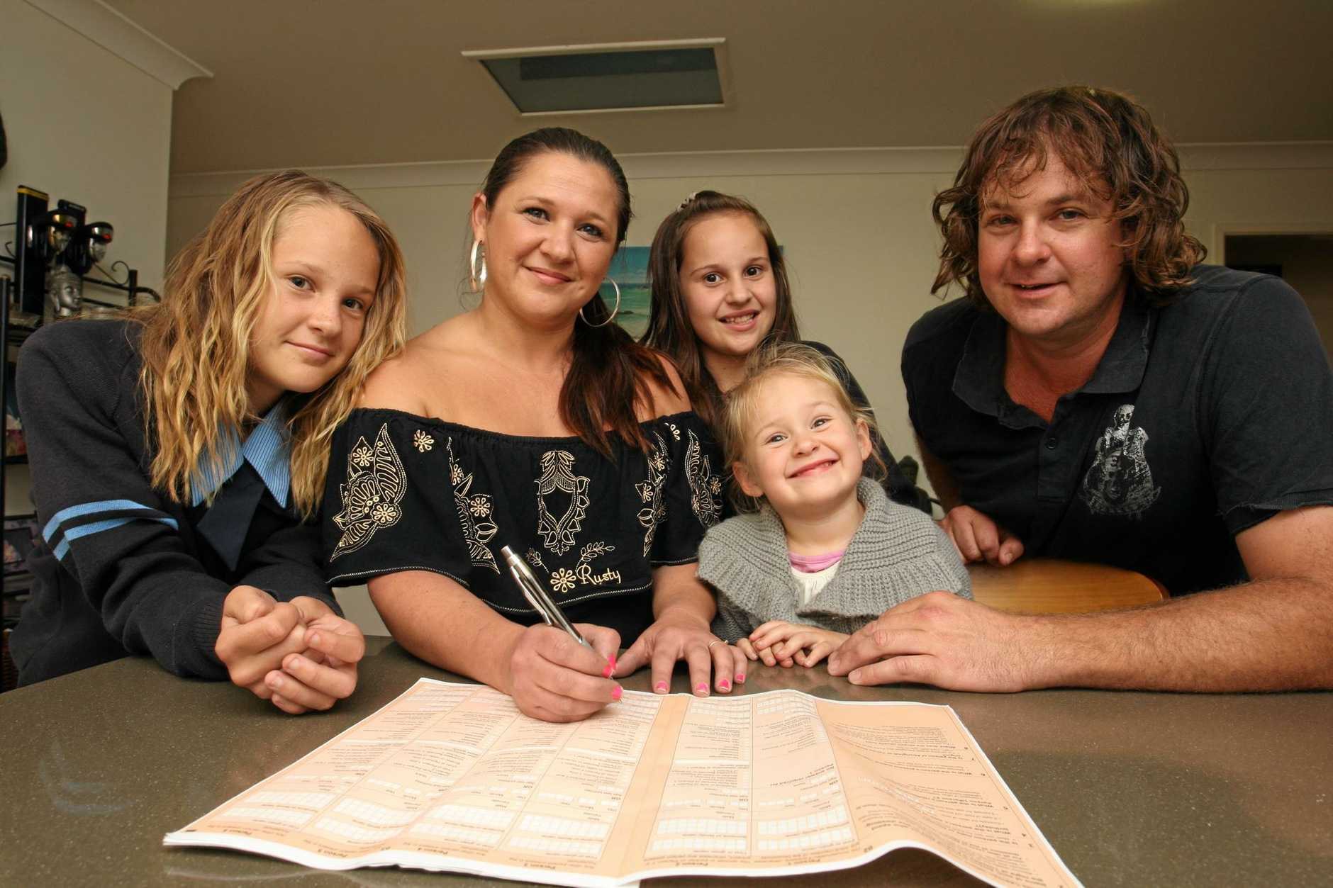 Wurtulla family Skye, 13yo, Leanne, Zoe, 11yo Holly,3yo and Todd Williams look over the Census form that they will fill out next week.Photo: Nicholas Falconer / Sunshine Coast Daily